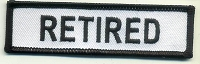 Retired Patch White with Black Border, Black Lettering, 4